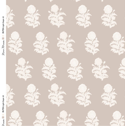 Linen fabric printed with a small white floral botanical repeated pattern on a coloured background
