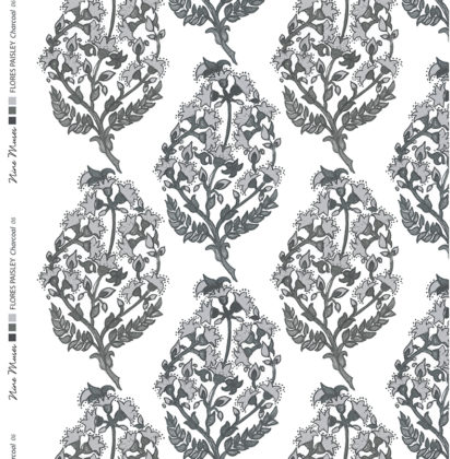 Linen fabric printed with a delicate hand painted floral paisley repeat pattern in charcoal on white background