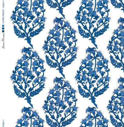 Linen fabric printed with a delicate hand painted floral paisley repeat pattern in indigo navy blue on white background