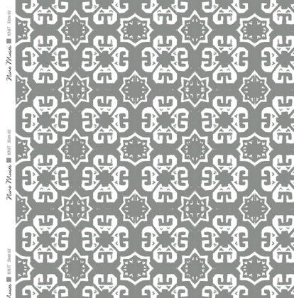 Linen fabric printed with a geometric knit repeat pattern in two shades of slate grey
