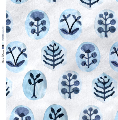 Linen fabric printed with a hand painted botanical design repeat pattern in green and navy blue on pale blue background