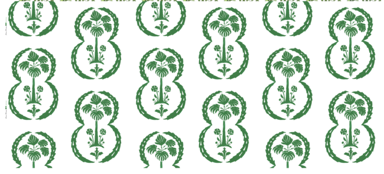 Linen fabric printed with repeat pattern of palm design in green