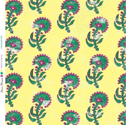 Linen fabric printed with a hand painted floral plant design repeat pattern in green and red on yellow background