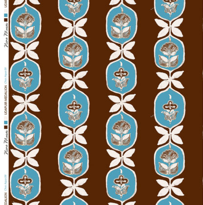 Linen fabric printed with hand painted floral stripe medallion design repeat pattern in blue on chocolate brown background