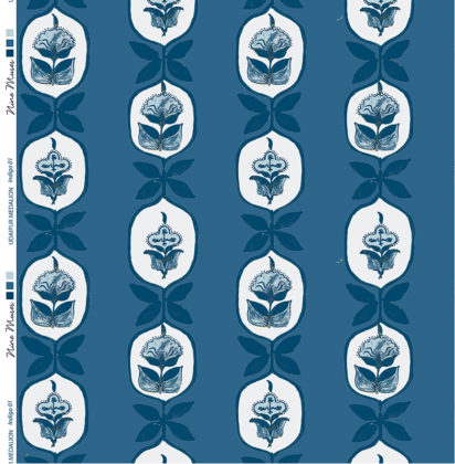 Linen fabric printed with hand painted floral stripe medallion design repeat pattern in pale blue on indigo blue background