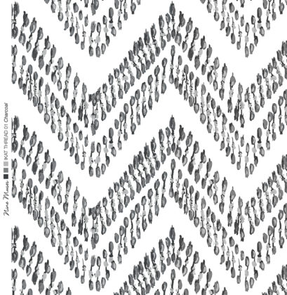 Linen fabric printed with ikat zigzag repeat design with monochrome charcoal grey pattern on white background