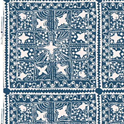 Linen fabric printed with stripe and diamond quilt repeat pattern in white on navy blue background