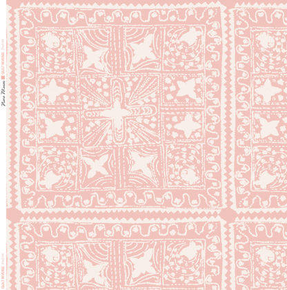 Linen fabric printed with stripe and diamond quilt repeat pattern in white on pale shell pink background