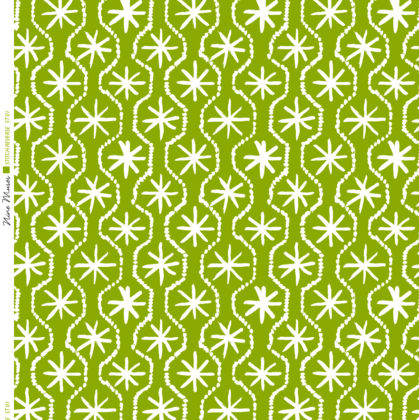 Linen fabric printed in hand painted design repeat pattern of star stitch detail in white on bright olive green background