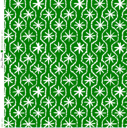 Linen fabric printed in hand painted design repeat pattern of star stitch detail in white on bright mid green background