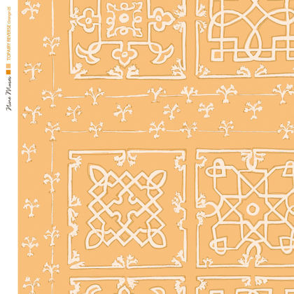 Linen fabric printed with traditional decorative square design like a garden plan repeat pattern in white on orange background