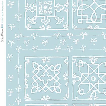 Linen fabric printed with traditional decorative square design like a garden plan repeat pattern in white on pale blue background