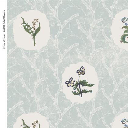 Linen fabric printed with a repeat design of delicate floral botanical plant pattern in white circles on pale blue background