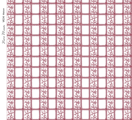 Linen fabric printed with delicate hand painted grid design and small repeat pattern in red pink on white background